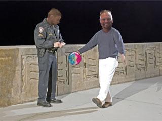Officer Hofmann cites Dennis Walling for bowling while sober